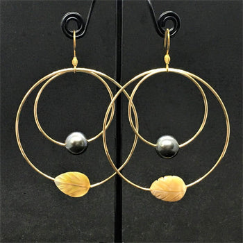 hoop earrings look with little orange leaves