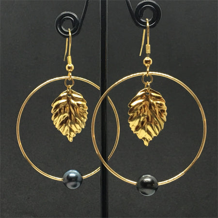 hoop earrings look with golden thick leaf