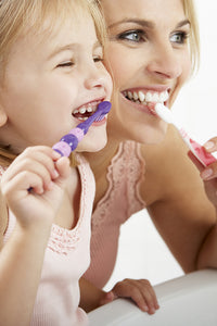 Mother Daughter Brushing Teeth