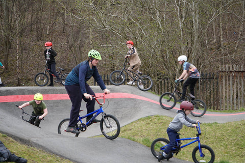 children riding at the pump track