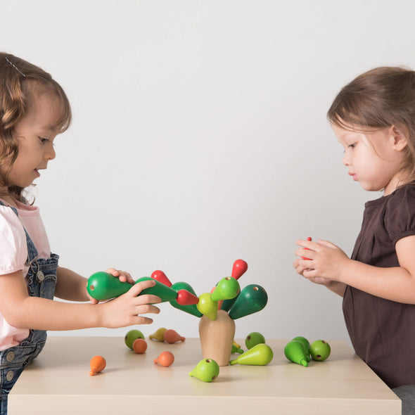 Kids playing with the Balancing Cactus by Plan Toys