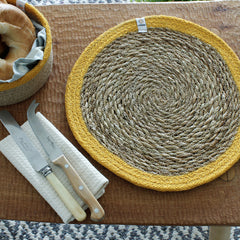 Seagrass & Jute Tablemat in Yellow on table