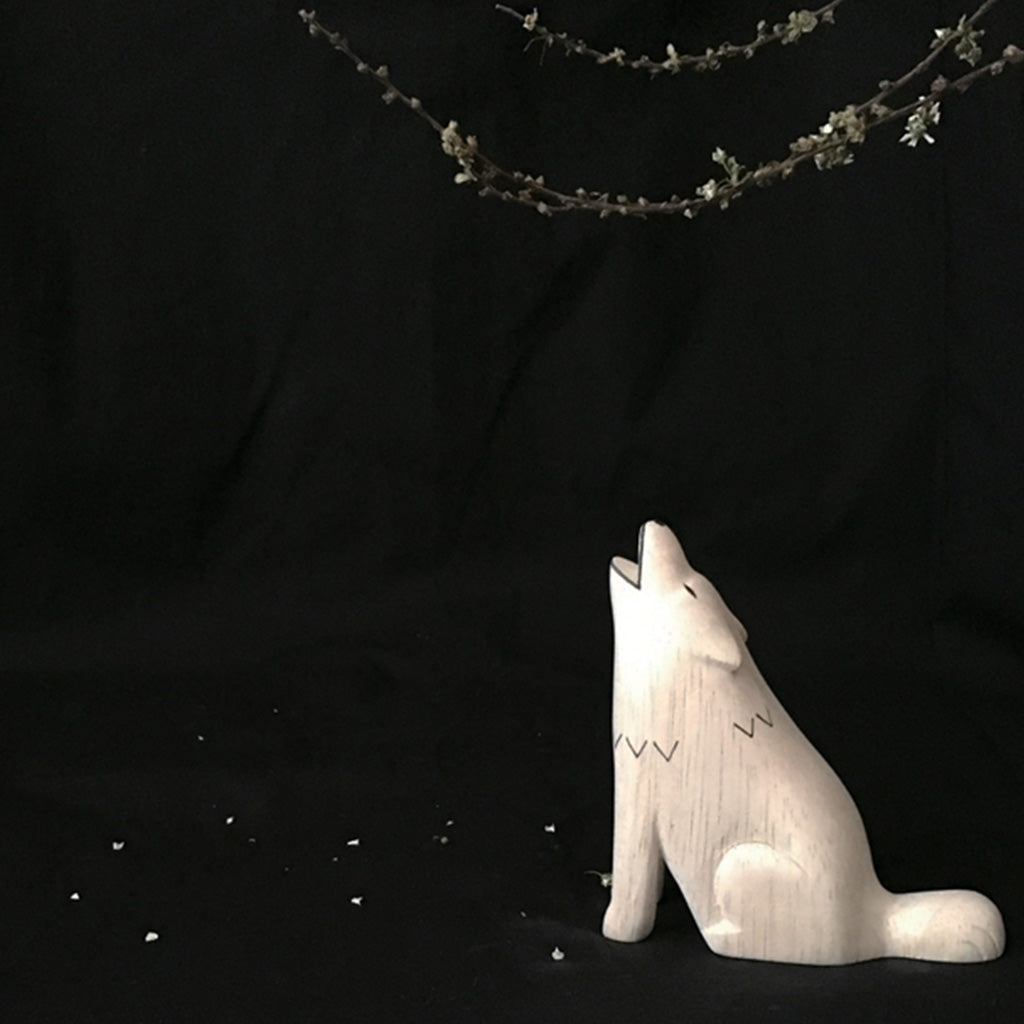 Pole Pole Animal Wolf carving in the night sky by T-Lab