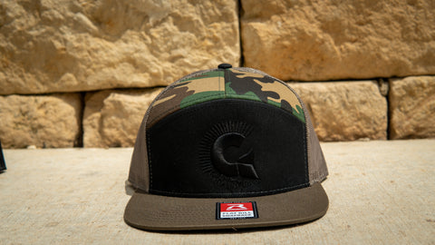 M81 7 Panel Trucker Snap Back with Black Logo