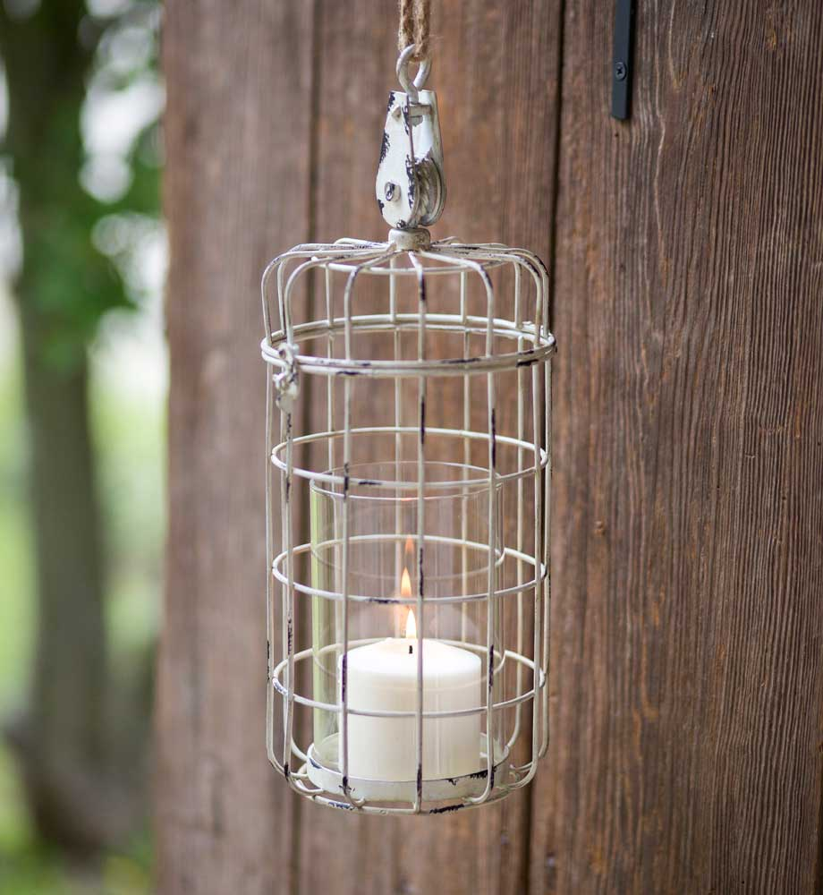 large hanging candle holder with a rustic cage