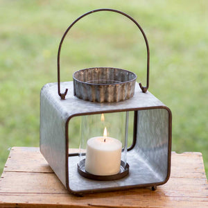 large tin candle lantern in the outdoors