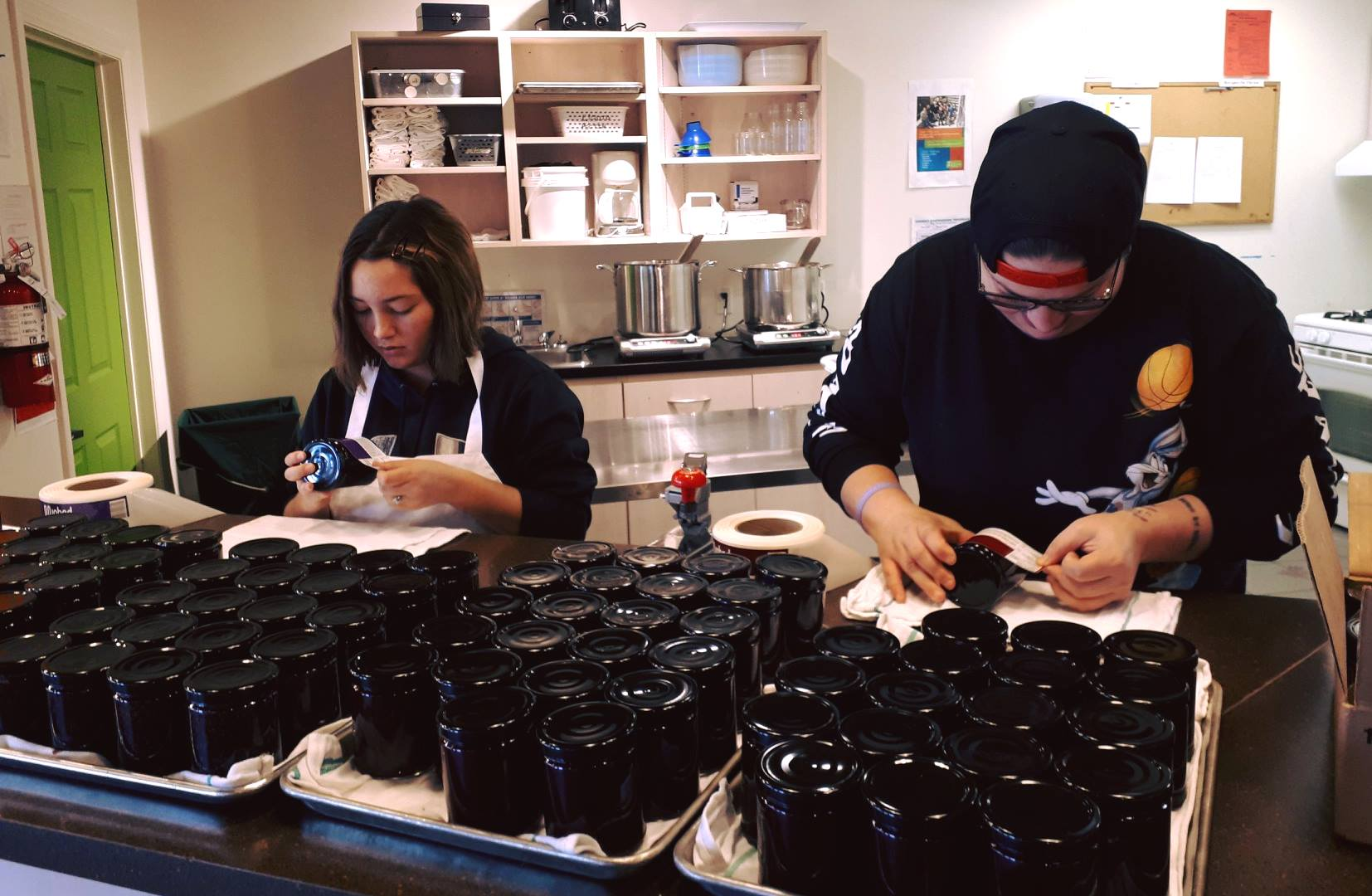 Youth apply labels to Mushed by YOU Jams