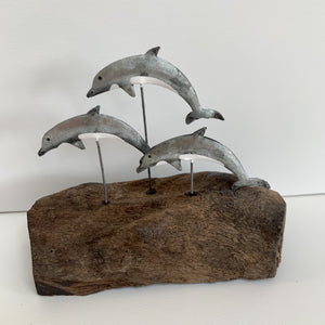 Silver Dolphins on Driftwood