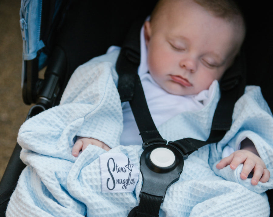 Is it safe to cover your baby's pram with a blanket in hot weather?