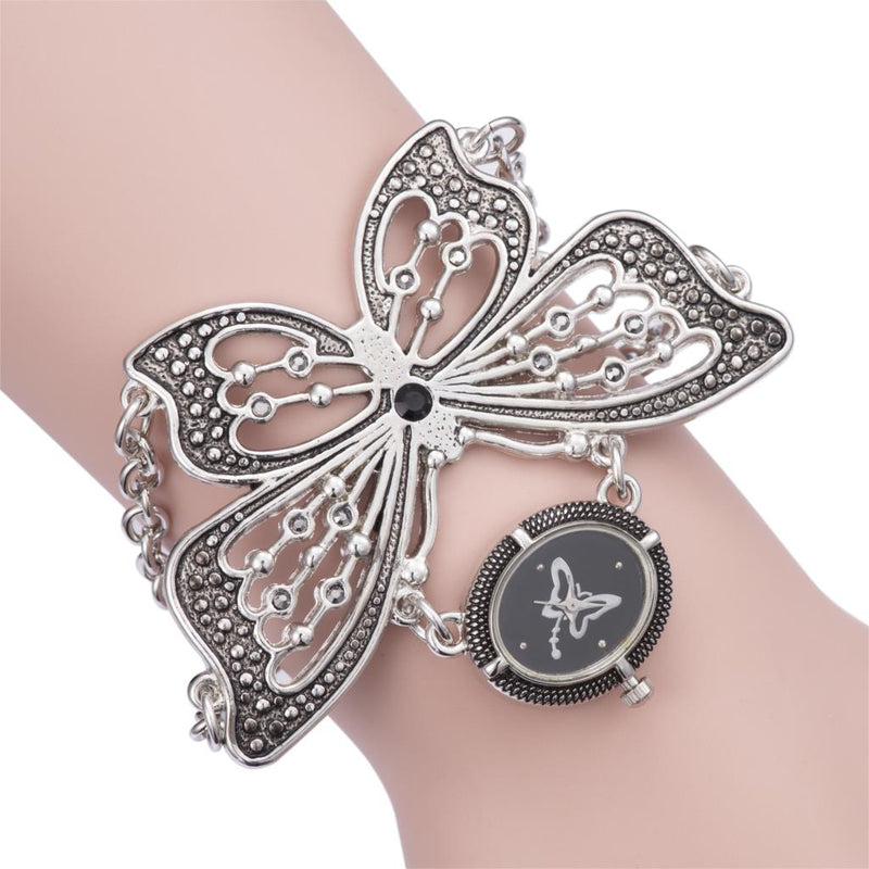 HOT SALE Classic Retro Black Titanium Silver Women Quartz Wrist Watch Stylish Oversize Butterfly Bracelet Watches Cute Mini Dial