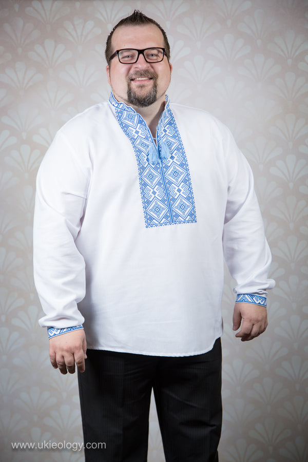 White shirt with blue embroidery