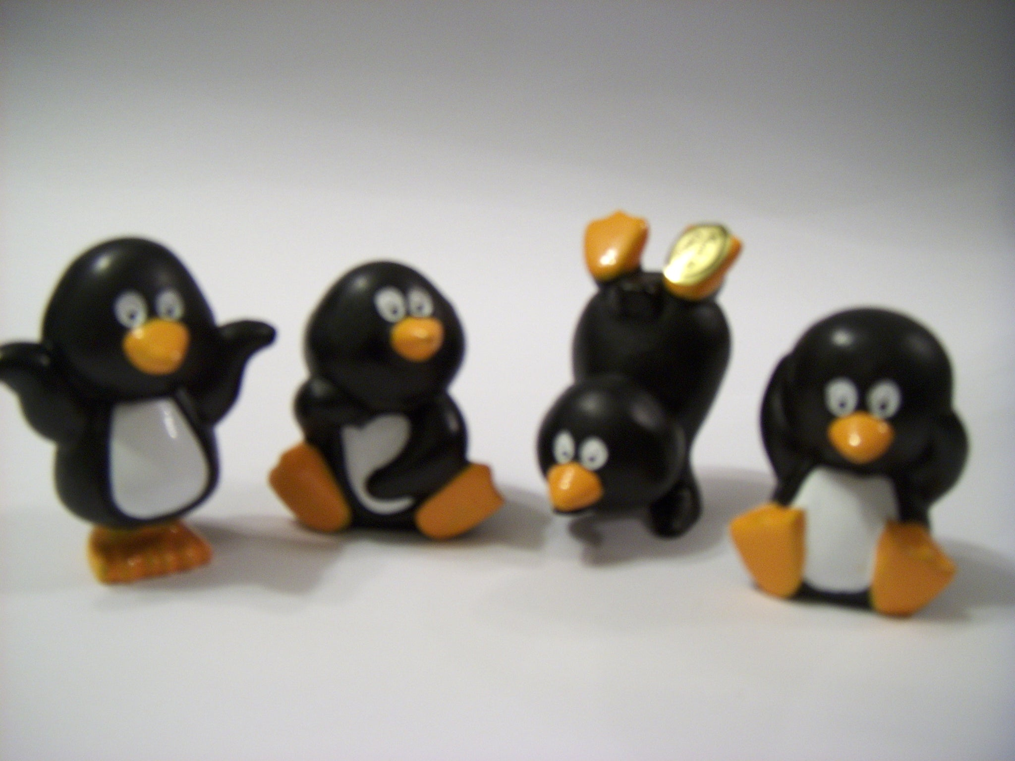 Penguins - 40mm. Design may vary