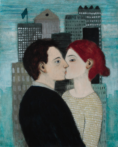 A couple kissing against a cityscape background and turquoise sky. She is weary beige and white top and he is in black.