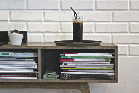 cold brew coffee book shelf with books brick background