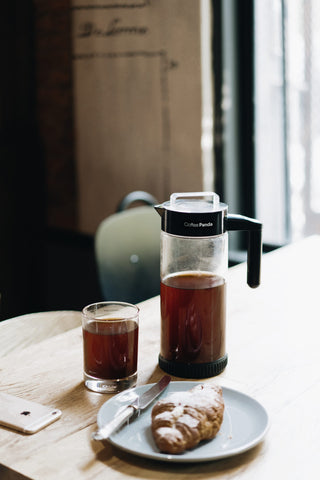 cold brew coffee maker with croissant