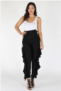 Solid high waisted pants with lace up detail, ruffle accent, and zipper closure at back