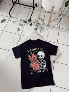 FIGHTING MY DEMONS T-shirt *Available after May 3rd] Disponible despues del 3 de Mayo