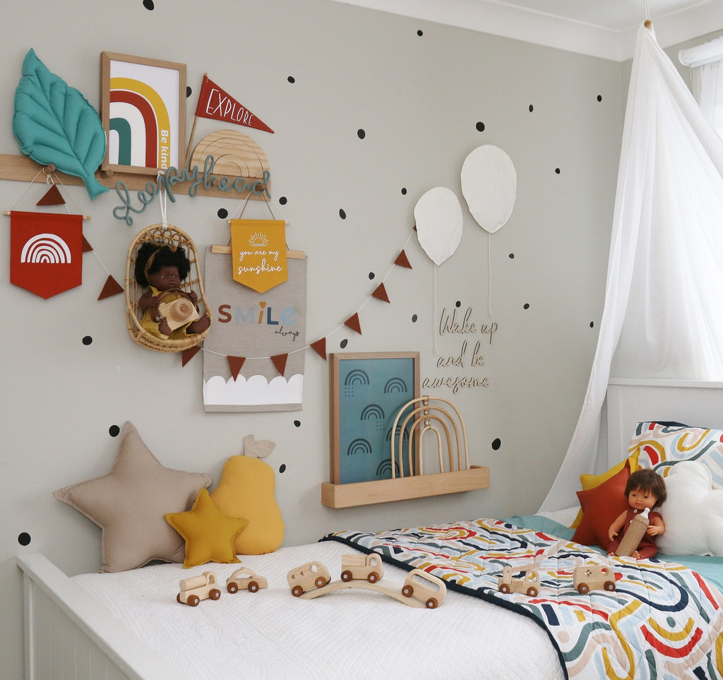 Colourful Kids room with bright motivational decorations on wall and wooden toys