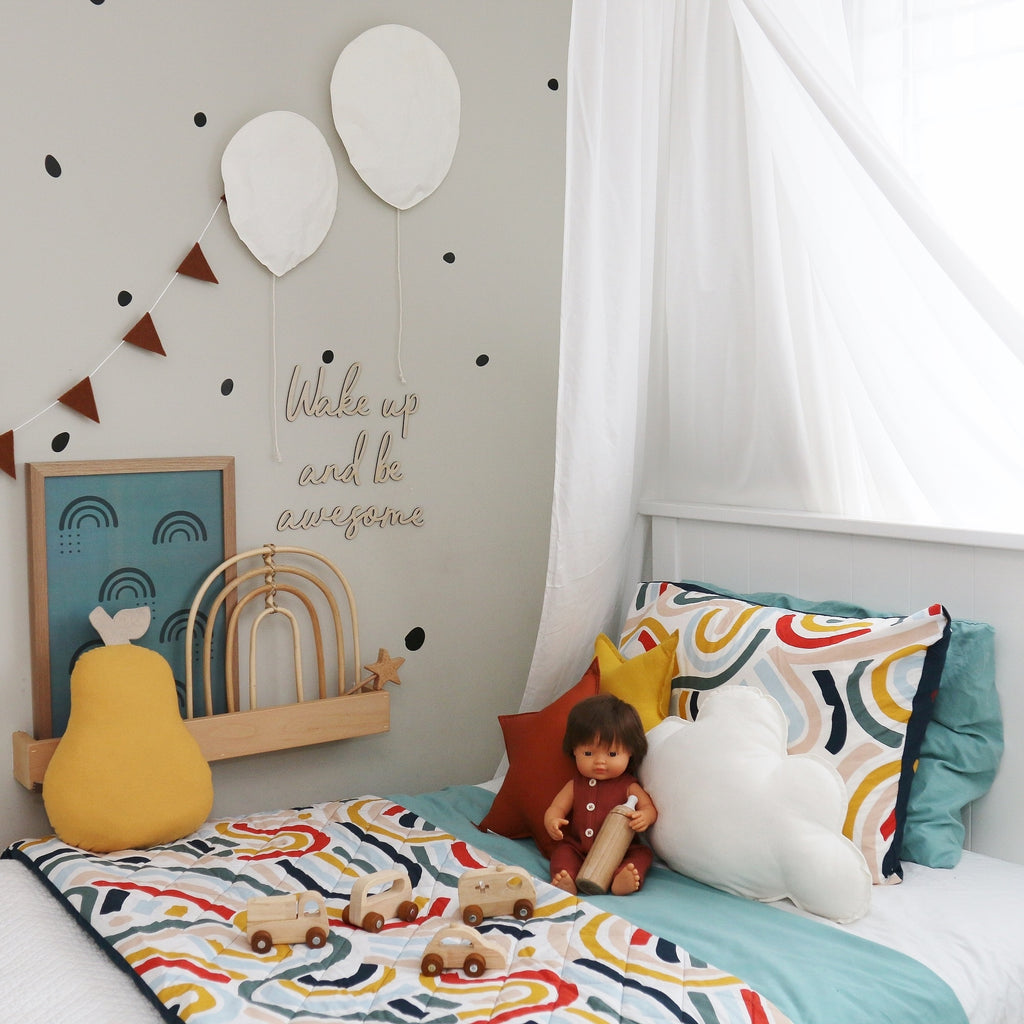 A  Colourful Kids' Room with bright bedspread and wooden toys