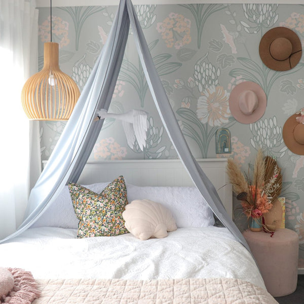 light grey drape canopy hanging above double size bed in girls bedroom