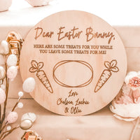 A round raw mdf engraved tray for easter bunny treats sitting upright on a box