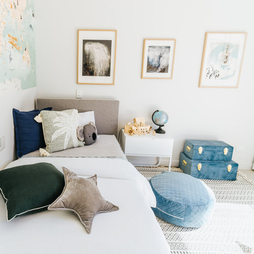 boys bedroom with blue and gold storage cases sitting on the floor