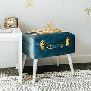 blue stool with gold clips sitting in boys bedroom with puzzle on top