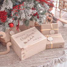 Load image into Gallery viewer, Timber christmas eve box sitting under christmas tree decorated in read and white decorations. Sitting next to presents wrapped in brown paper.