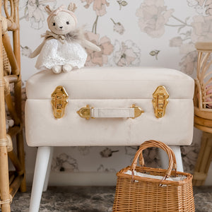 front view of bone coloured storage stool with gold handles