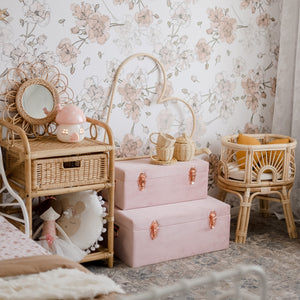 set of two dusty pink storage cases in girls bedroom