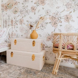 set of two bone coloured storage cases witting in girls bedroom next to baby dolls bed