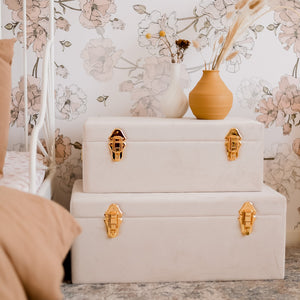set of two bone and gold storage cases in girls bedroom