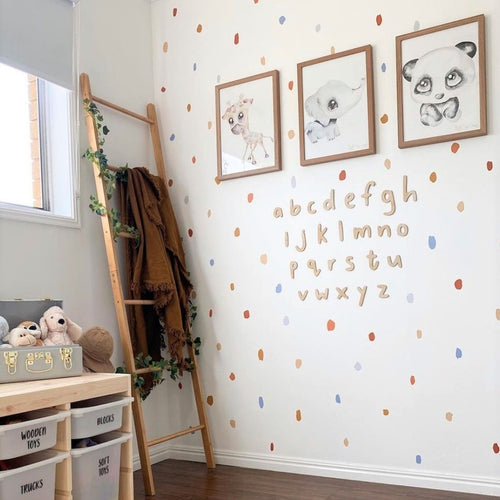 Timber alphabet on wall with wall decals and three picture frames
