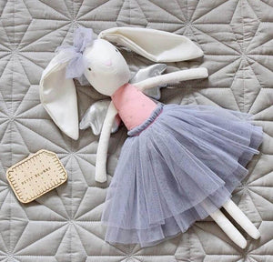 linen bunny laying on bed with grey tulle skirt and bow on head and silver wings