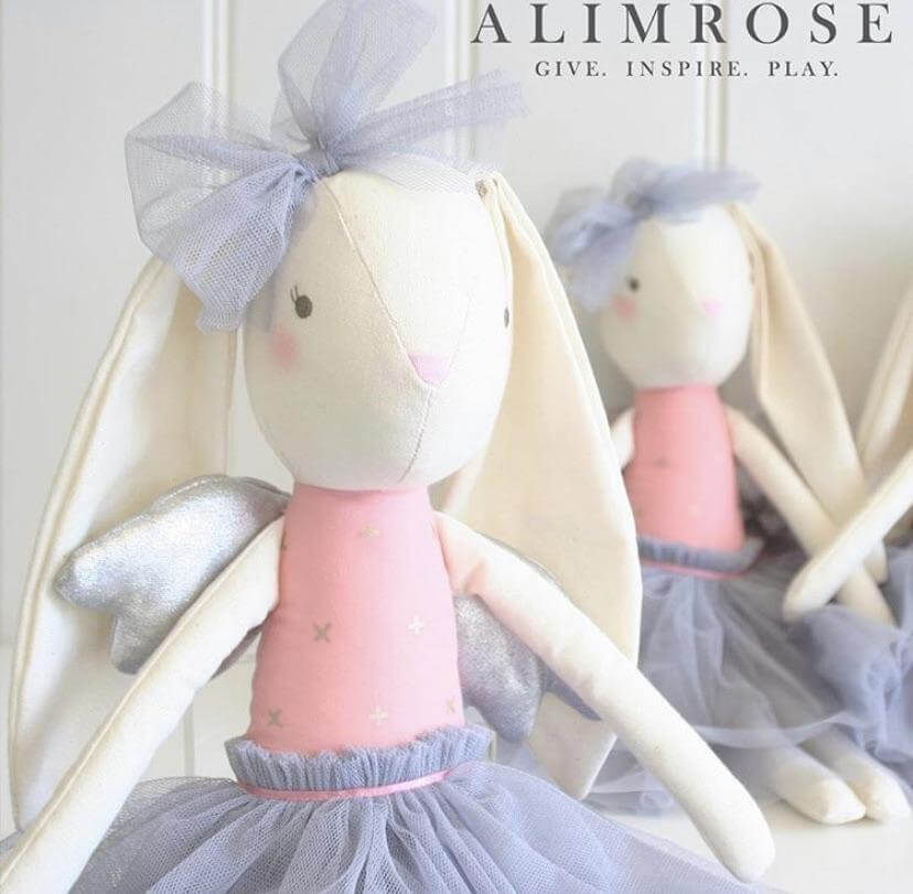 two pink and grey fabric bunnies with silver wings and embroided face