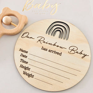 timber round birth announcement plaque with a rainbow on top