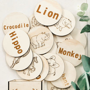 hand made circular timber discs etched with safari animals and name names
