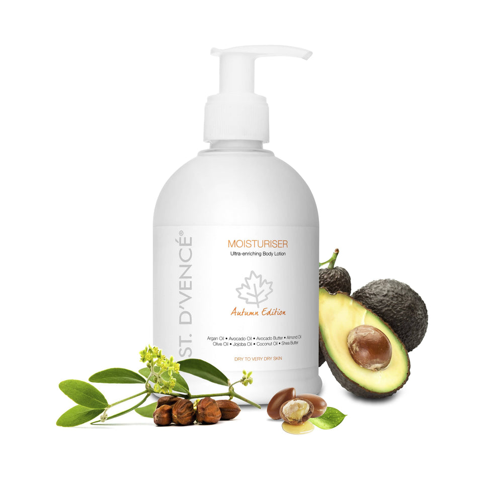 St. D'vence Autumn Edition Body Moisturiser  with Argan Oil & Avocado Butter, 300 ml with freshly cut Avocado fruit and Argan seeds around the bottle.