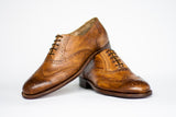 Handmade Tobacco Oxford Brogues wingtips one shoe on the top of the other