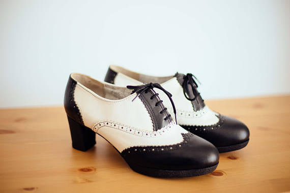 side view black and white handmade oxford wingtips with heel