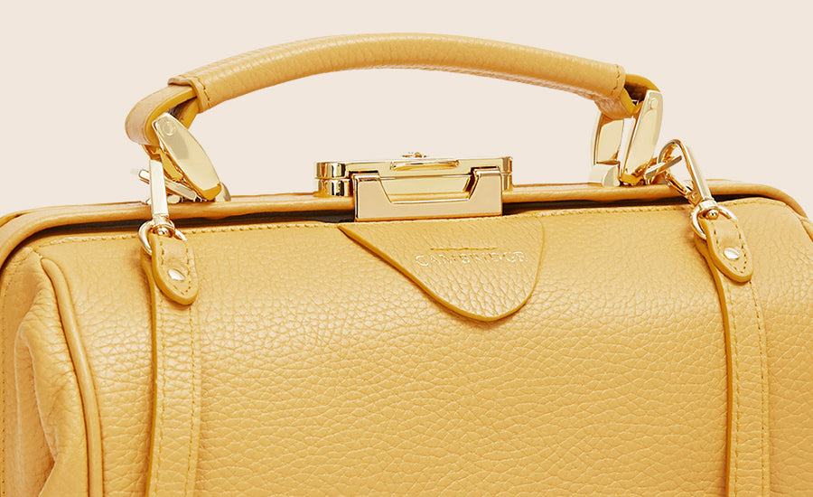 Soft calf grain leather with gold CAMBRIDGE embossing