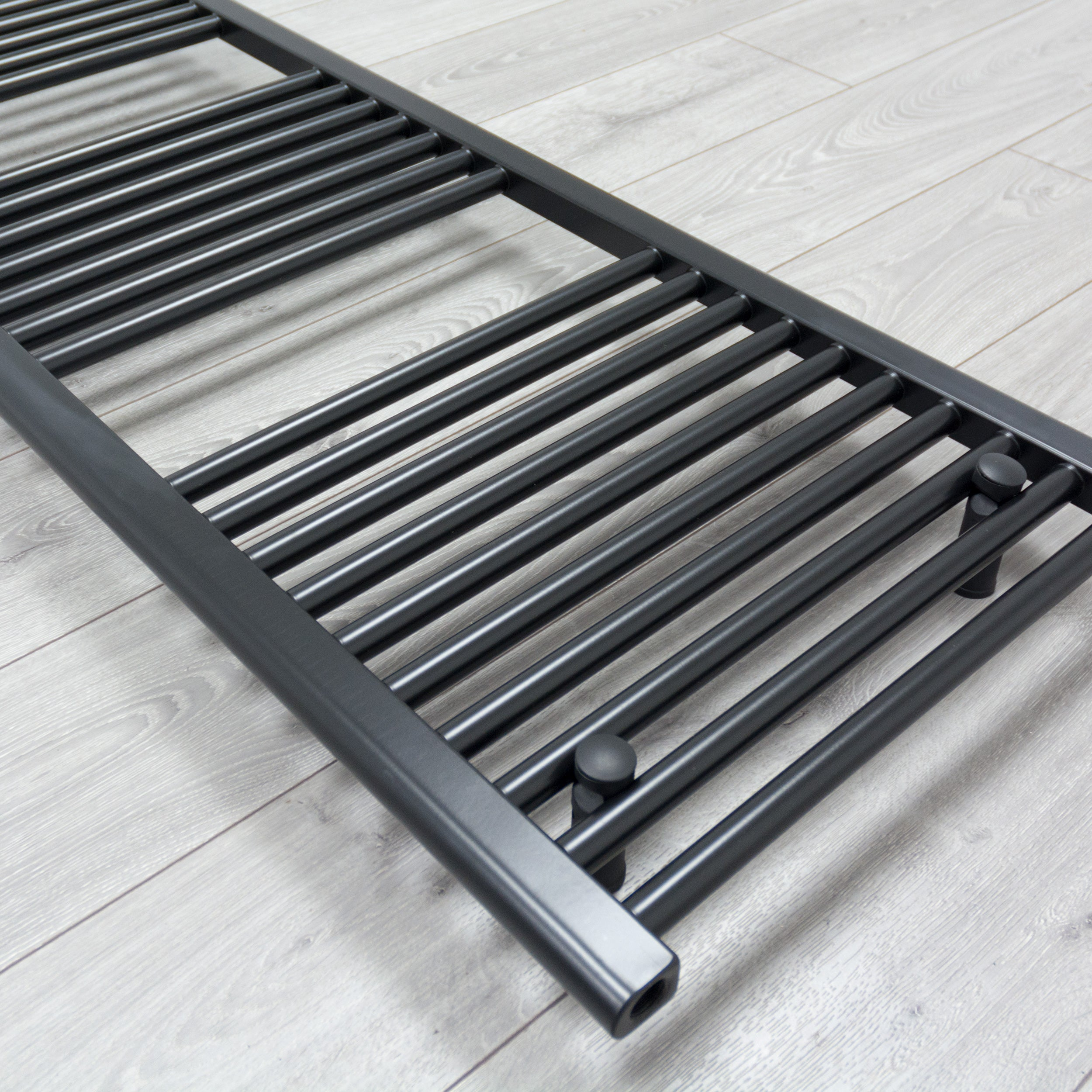 600mm Wide 1400mm High Flat Black Heated Towel Rail Radiator