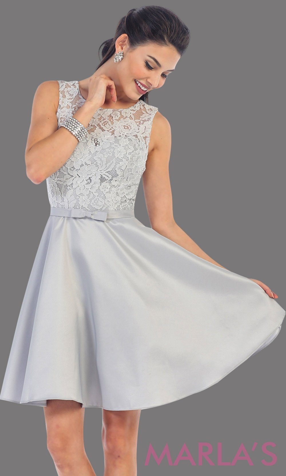 Short simple  semi formal ligth gray dress with lace bodice and satin skirt. Light silver dress is perfect for grade 8 grad, graduation, short prom, damas quinceanera, confirmation. Available in plus sizes.