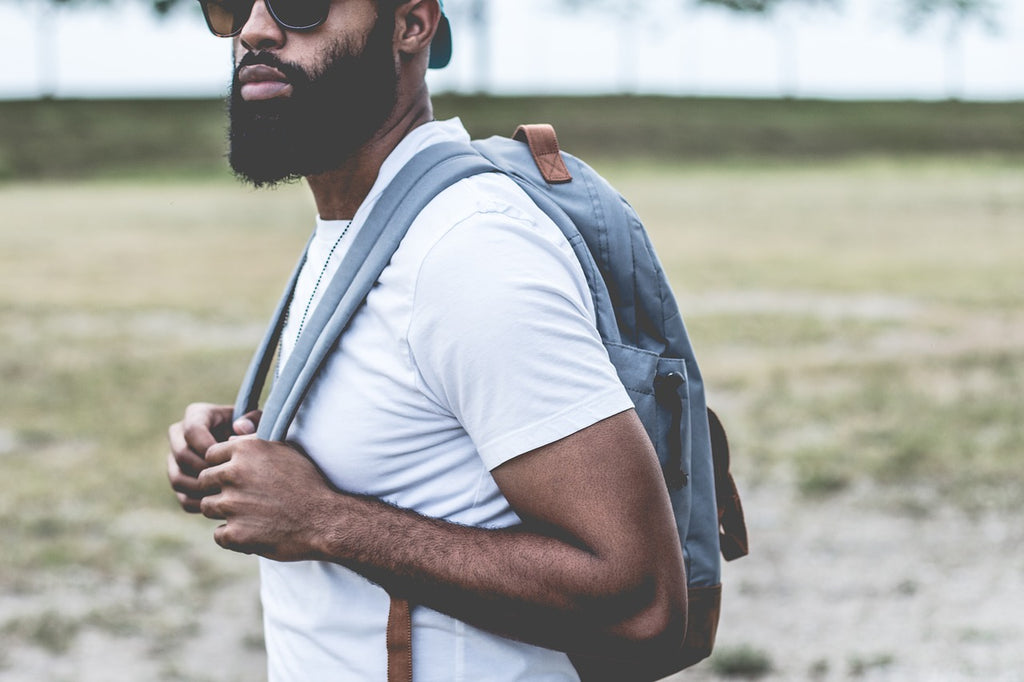 Bearded guy in sunglasses wearing a backpack