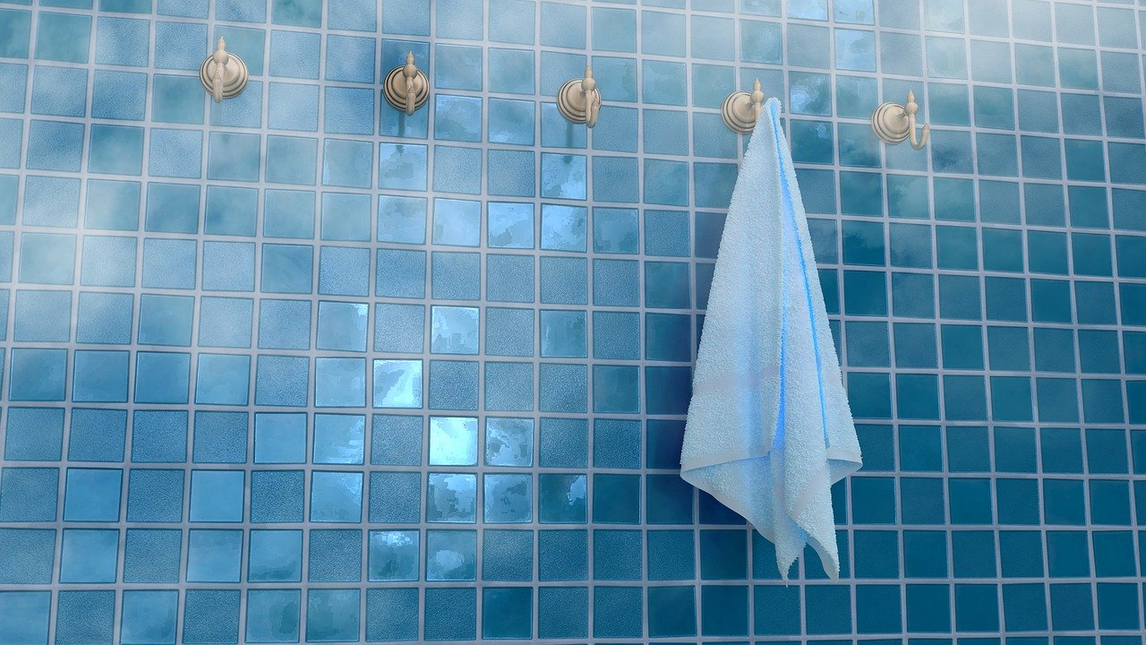 A towel hanging in a steamy shower
