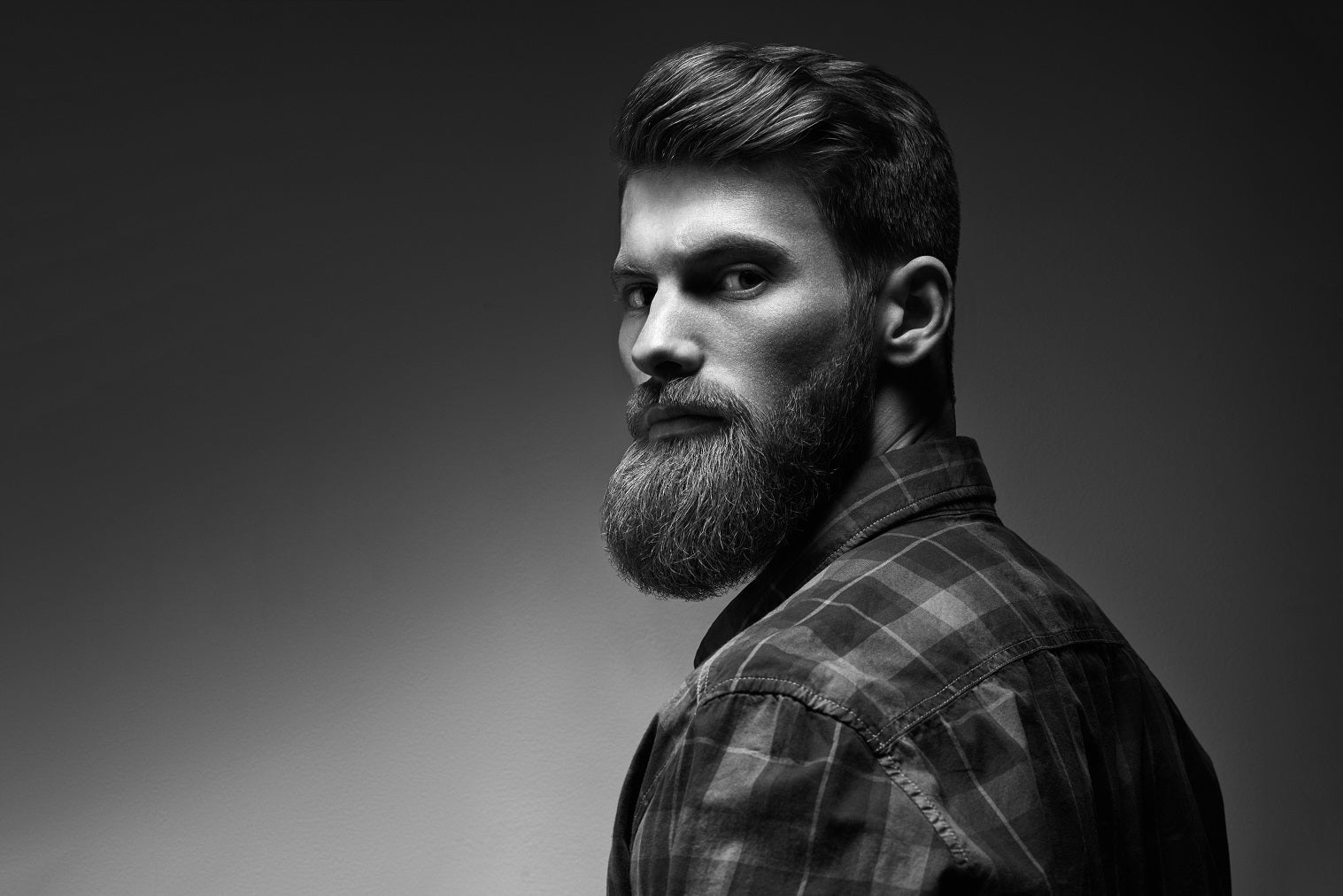 Modern man with a full beard wearing a flannel shirt