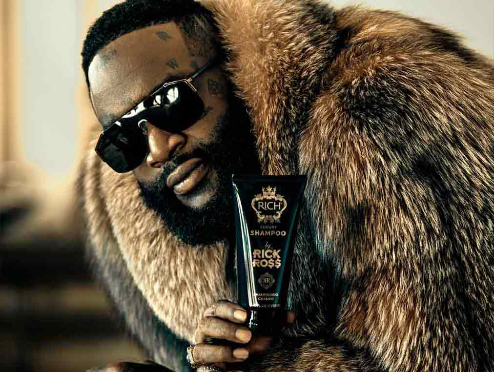 Rick Ross holding RICH by Rick Ross shampoo