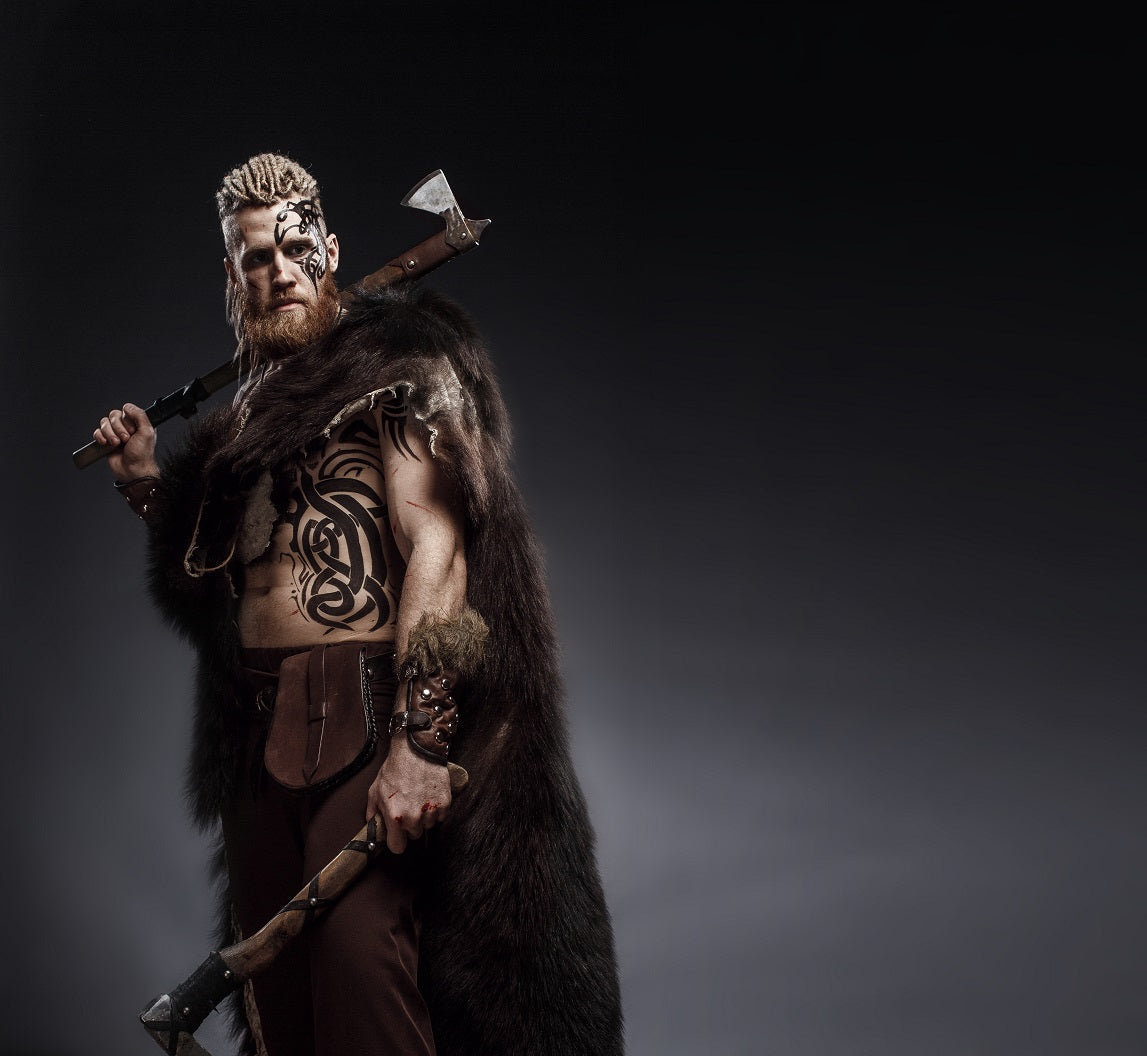 Bearded Viking warrior wielding two axes