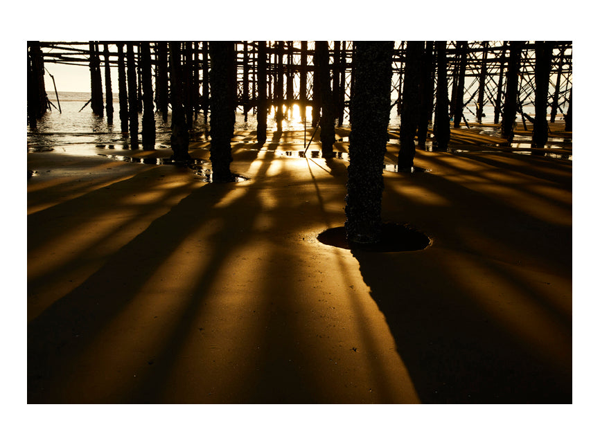 Beneath the Blackpool pier in summer