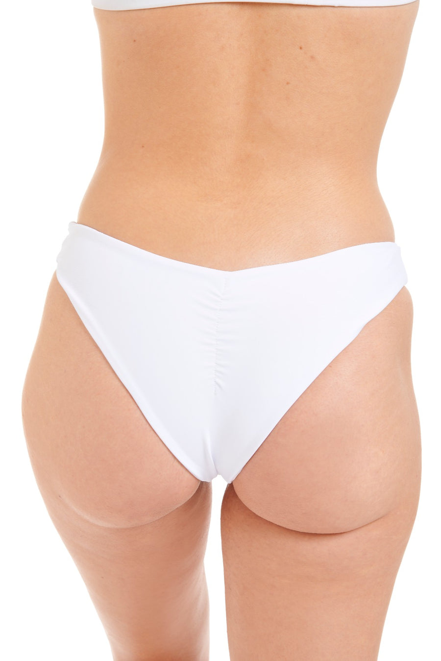 Close up back view of a woman in white swim bottoms
